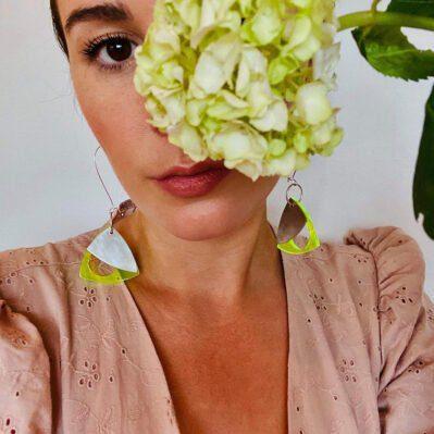 Model Wearing Pewter And Perspex Earrings Handcrafted By Ceciel Van Oevelen