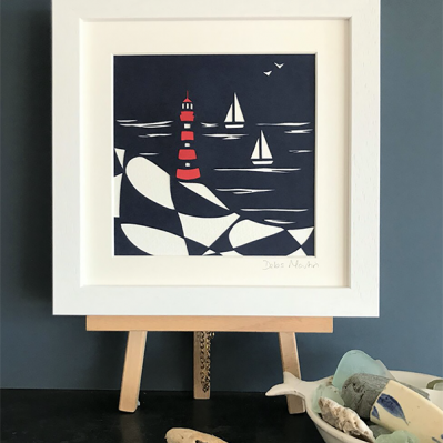 Handcut lighthouse paper art by Cornish Papercut Art