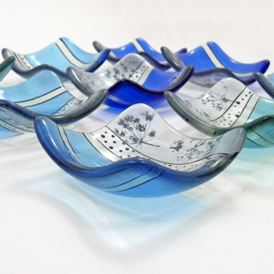 Blue glass dishes by Naomi Singer