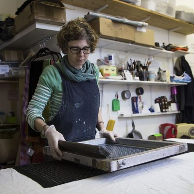 Rachel Stowe printing at the workbench