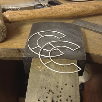 Pair Of Zaleika Anna Silver Earrings On The Bench Peg