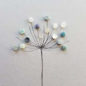 Floral Artwork Created From Beach Plastic By Smartie Lids On The Beach