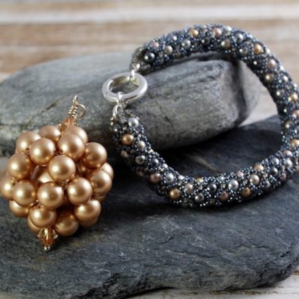 Beaded bracelet in grey and gold tones made from Swarovski pearls closed with a sterling silver clasp by Article Jewellery with beaded long length vintage gold pendant