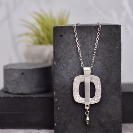 Square textured silver pendant necklace with crystal by Article Jewellery