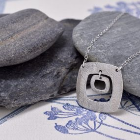 Silver Square Pendant With Charm