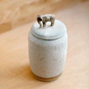 Tall stoneware jar with elephant handle on lid by Potting in Penryn