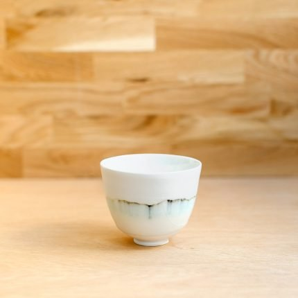 White porcelain bowl with green glaze pattern by Sarah Cooling