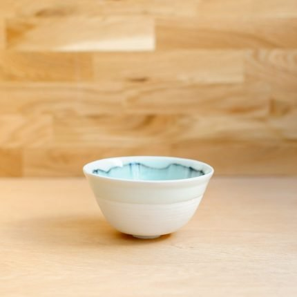 White porcelain bowl with green glaze pattern inside by Sarah Cooling
