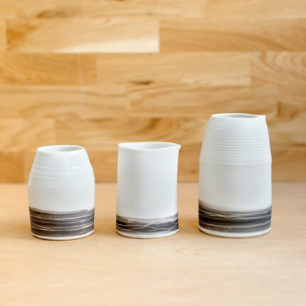 White porcelain jugs and vase with brown landscape inspired stripe pattern by Sarah Cooling