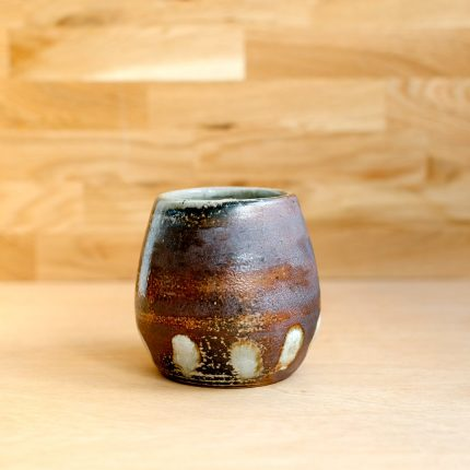 Brown woodfired stoneware vase with dot pattern by Bridie Maddocks