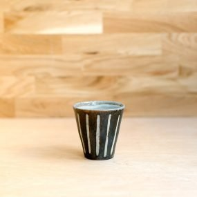 Woodfired stoneware beaker with brown and grey vertical stripe pattern by Bridie Maddocks