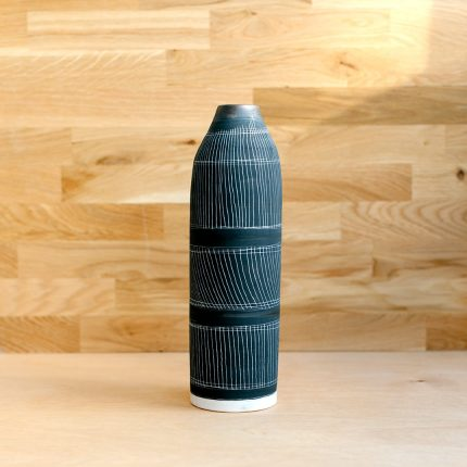 Tall slim black porcelain with sgraffito bottle by Sarah Cooling