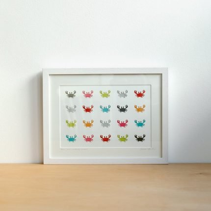 Framed artwork featuring a rows of brightly coloured paper cut crabs by Cornish Paper Cut Art
