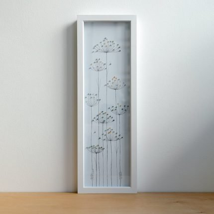 Tall framed picture of seedheads made from beach find plastic by Smartie Lids on the Beach
