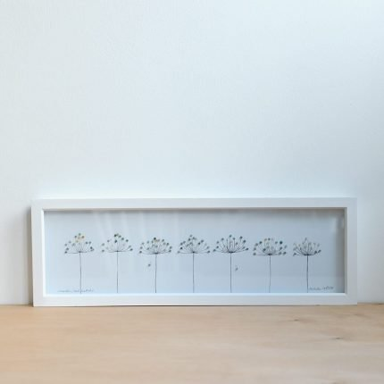 Long framed picture of seedheads made from beach find plastic by Smartie Lids on the Beach
