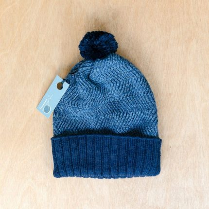 Blue bobble hat by Jessye Boulton