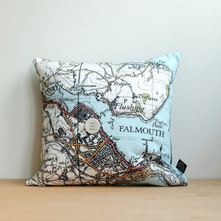 """Cushion with vintage map print of Falmouth and ceramic """"you are here"""" badge by Glorious Mud Ceramics"""