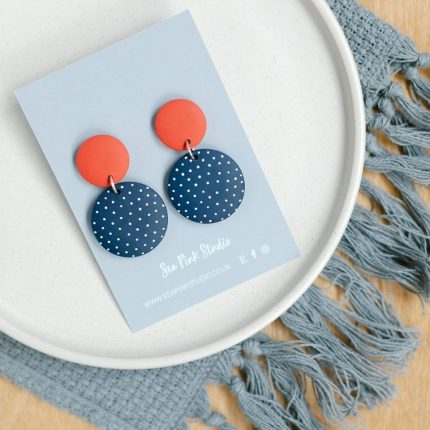 Navy with white spot painted wooden bead drop earrings with red stud fittings by Sea Pink Studio
