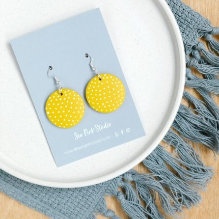 Porthmeor yellow and white spot painted wooden bead earrings with hook fittings by Sea Pink Studio