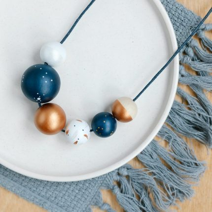 Navy and copper painted wooden bead necklace by Sea Pink Studio