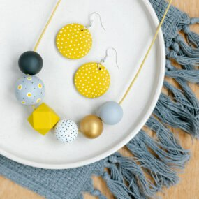 Grey And Yellow Painted Wooden Bead Necklace And Matching Drop Earrings With Hook Fittings By Sea Pink Studio