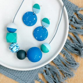 Green and blue painted wooden bead necklace and matching drop earrings with stud fittings by Sea Pink Studio