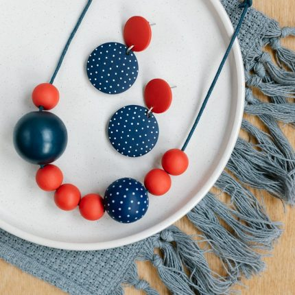Navy and red painted wooden bead necklace and matching drop earrings with stud fittings by Sea Pink Studio