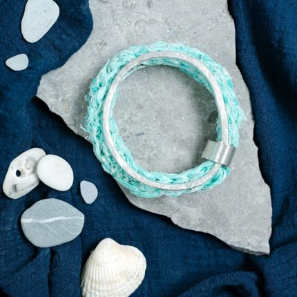 Statement bangle made from a hammered eco-silver and crocheted ghostnet bangle joined by an eco-silver band by Sarah Drew