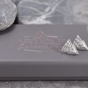 Triangular silver stud earrings by Article Jewellery with box