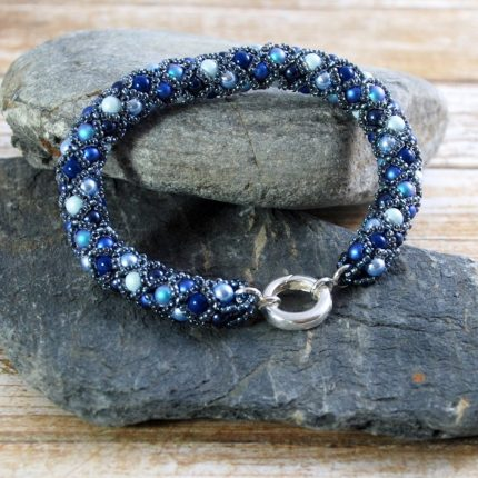 Beaded bracelet in blue tones made from Swarovski pearls closed with a sterling silver clasp by Article Jewellery