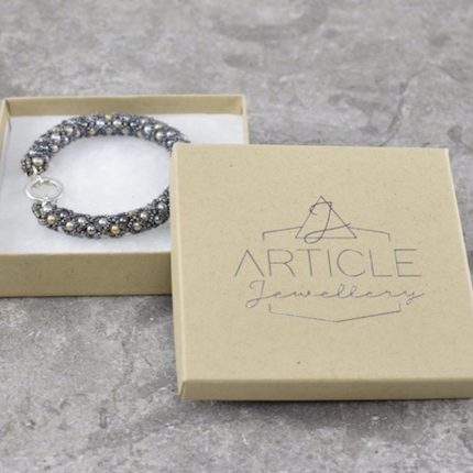 Beaded bracelet made from Swarovski pearls closed with a sterling silver clasp by Article Jewellery with box