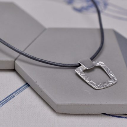 Tapered square textured silver pendant on leather necklace Article Jewellery