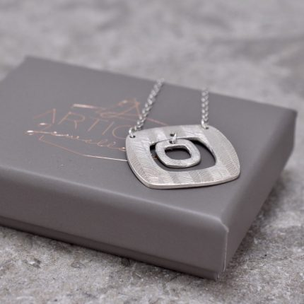 Square textured silver pendant necklace with charm by Article Jewellery with box