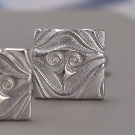 Close up of square silver cufflinks with textured pattern by Article Jewellery