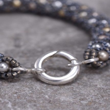 Close up of Swarovski pearl beaded bracelet sterling silver clasp by Article Jewellery