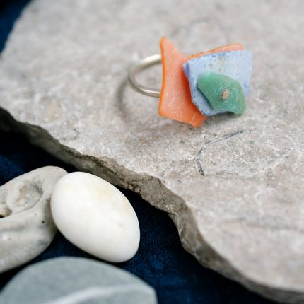 Statement ring made with riveted layers of beach plastic on an eco-silver band by Sarah Drew