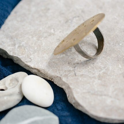 Brass and eco-silver statement ring by Sarah Drew