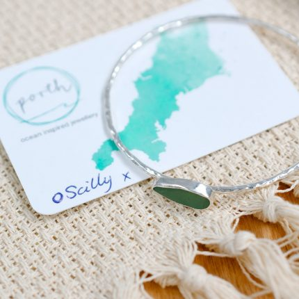 Deep green seaglass and textured sterling silver bangle created with a piece found in the Isles of Scilly by Porth Jewellery