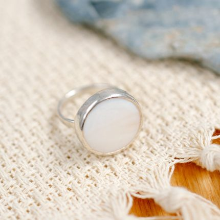 Sterling silver ring inset with a disc of white Mother of Pearl by Porth Jewellery