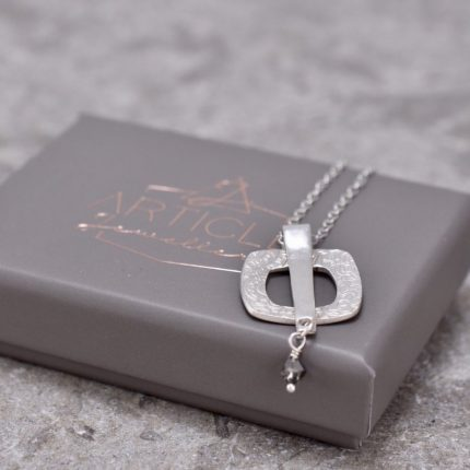 Square textured silver pendant necklace with crystal by Article Jewellery with box