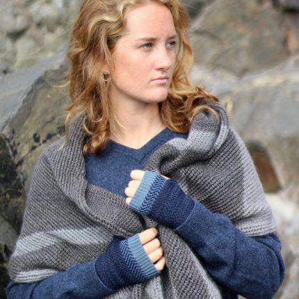 Model wearing wrap scarf by Cornish Knitwear designer Jessye Boulton
