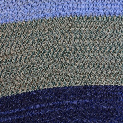 Close up of texture in handknitted racked scarf in green and blues by Jessye Boulton